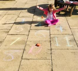 Alice playing a chalk maths game